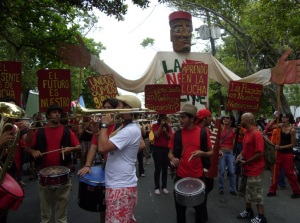 "Members of the street theater group called ""Papel Machete"" leading one of the many student marches during the 2010-2011 UPR student strikes."