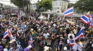 Tens of thousands descend on Bangkok to demand the resignation of Prime Minister Yingluck Shinawatra and her Pheu Thai party.