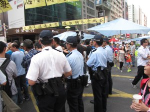 Police presence in Mong Kok to prevent social flareups and violence.