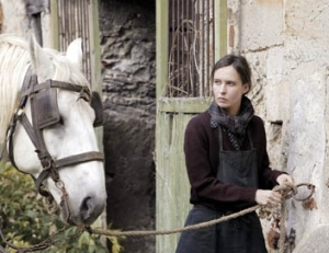 Nade Dieu plays Marie Germain, a farmer who becomes the leader of the local French Resistance